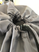 Closeup of Grey Polyester Laundry Bag Toggle Drawstring Closure